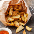 Fried potato &quot;country-style&quot; in kraft bag - Photo
