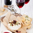 Baked Camembert cheese with red wine and toasted bread — Stock Photo #24482467