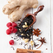 Dry tea leaves with  raspberry and spice - Stock Photo