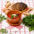 Bowl of homemade red borsch with sour cream and parsley — Stock Photo #24482639
