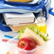Lunch box with sandwich apple and juice - Stock Photo