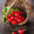 Fresh garden radish in wicker basket - Stock Photo