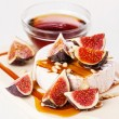 Cheese, figs and honey on light background - Foto Stock
