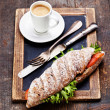 Sandwich with smoked salmon and coffee - Stock Photo