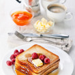 Royalty-Free Stock Photo: French toast with raspberries, maple syrup and butter