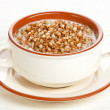 Stock Photo: Boiled buckwheat with milk