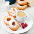 Donuts and coffee on morning breakfast table — Stock Photo