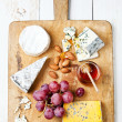 Assortment of various types of cheese - Stock Photo