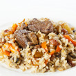 Uzbek national dish pilaf on white plate — Stock Photo