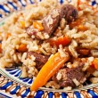 Uzbek national dish plov — Stock Photo #24483581
