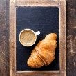 Coffee cup and croissant — Stock Photo