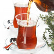 Tea thymus pour into glass cup — Stock Photo