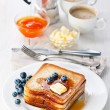 French toast with blueberries, maple syrup and butter - Stock Photo
