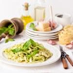 Pasta with pesto on white plate — Stock Photo #24483657