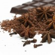 Anise stars, grated chocolate and chocolate plate - Stock Photo