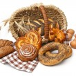 Royalty-Free Stock Photo: Assortment of baked bread with wheat in basket