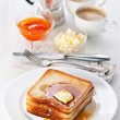 Golden brown french toast with syrup and butter — Stock Photo