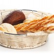 Breadsticks in basket on white background - Stock Photo