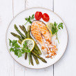 Grilled salmon with asparagus on white plate - Stock Photo