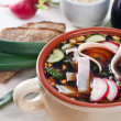 Cold kvass soup with chopped vegetables and meat - Stock Photo