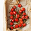 Baked tomatoes with herbs and olive oil - Stock Photo