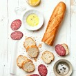 Baguette with sausage - Stock Photo