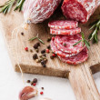 Italian salami on wooden cutting Board - Stock Photo