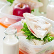 Lunch box with sandwich, apple and milk - Stock Photo