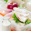 Lunch box with sandwich, apple and milk — Stock Photo