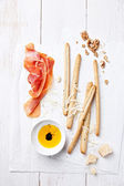 Cured Meat, Cheese and bread sticks — Stock Photo