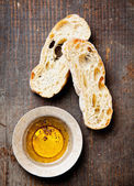 Italian food sliced Crusty bread ciabatta and extra virgin olive — Stock Photo
