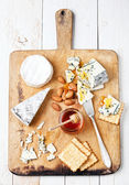 Assortment of various types of cheese — Stock Photo