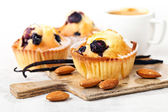 Three Homemade Blueberry Muffin cupcakes on white background — Stock Photo