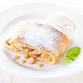 Apple strudel with vanilla ice cream and mint — Stock Photo