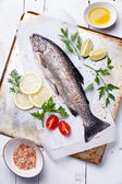 Fresh raw fish trout with herbs and lemon — Stock Photo