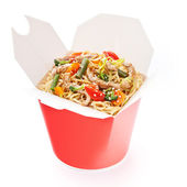 Noodles with pork and vegetables in take-out box on white backgr — Stock Photo
