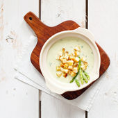 Asparagus soup cream with croutons — Stock Photo