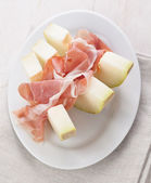Sweet melon with parma ham — Stock Photo