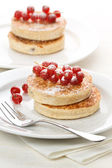 Pancakes topped with raspberries — Stock Photo