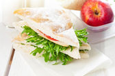 School breakfast with sandwich and apple — Stock Photo