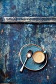 Espresso cup on blue background — Stock Photo