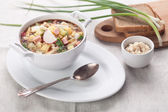 Cold kefir soup with chopped vegetables and meat — Stock Photo