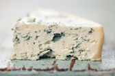 Piece of soft blue cheese — Stock Photo