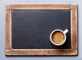 Coffee cup on vintage slate chalk board — Stock Photo