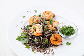 Black rice with prawns on white plate — Stock Photo