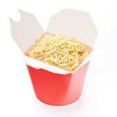 Noodles in take-out box on white background — Stock Photo
