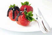 Strawberries in chocolate — Stock Photo