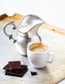Espresso cup with chocolate and milk — Stock Photo