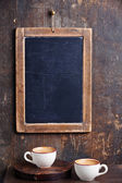 Coffee cup with vintage slate chalk board — Stock Photo