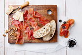 Chopping board of Cured Meat, Cheese and Olive — Stock Photo